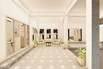Interior - Area depan rumah dengan tempak duduk di teras untuk menyambut tamu yang datang.