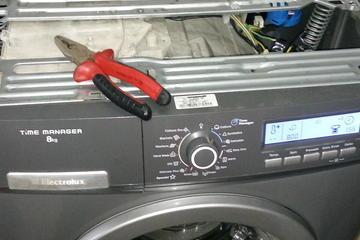 Perbaikan mesin cuci front load