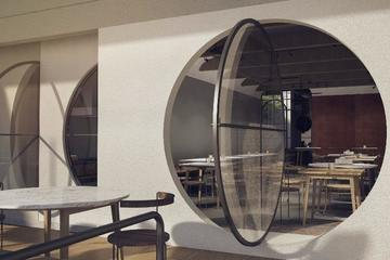Main rounded glass door for the restaurant.